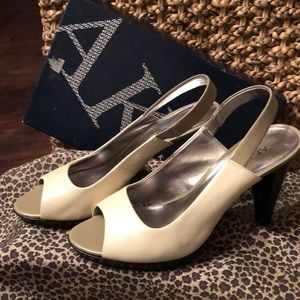 Like New!  Tri-colored peep toe heels.